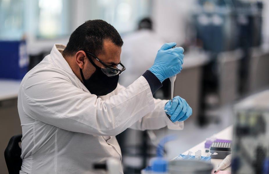 A researcher using a pipette