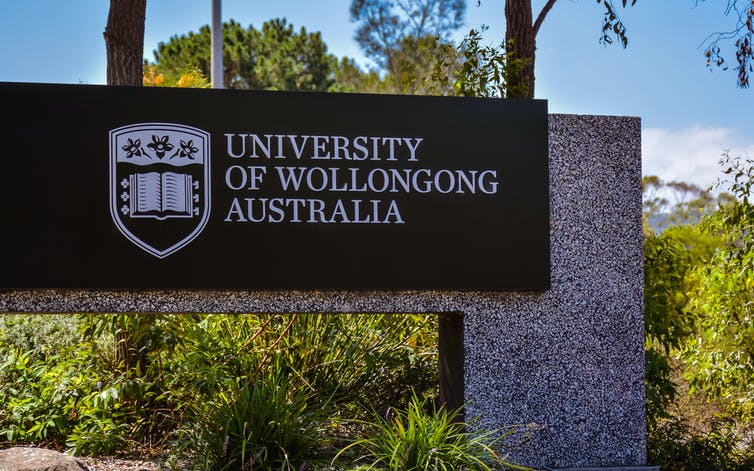 University of Wollongong sign at entrance to campus