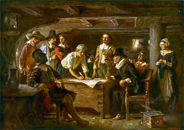 The signatories of the Mayflower Compact aboard the Mayflower.