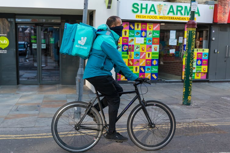 Deliveroo worker cycles down empty high street