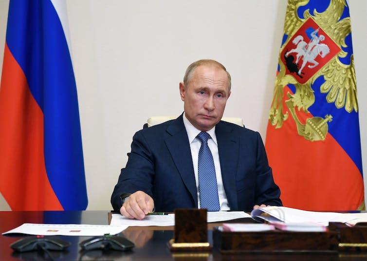 Vladimir Putin seated at a desk