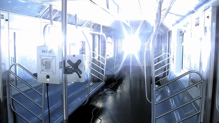 ultraviolet light filling the interior of an empty New York City subway car