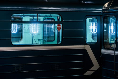ultraviolet light disinfecting the interior of empty Moscow subway car