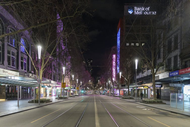 An empty Melbourne street at night.