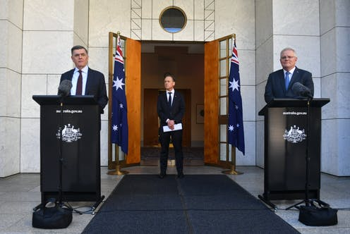 Brendan Murphy, Greg Hunt, and Scott Morrison, at a press conference