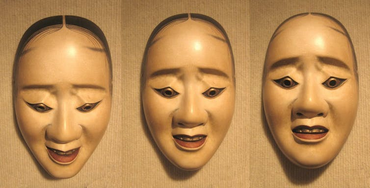 Pictures of the same mask with different expressions depending on the angle.