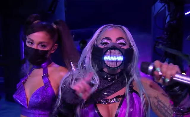 Lady Gaga in a facemask with a sound wave and Arianna Grande in a black face mask.