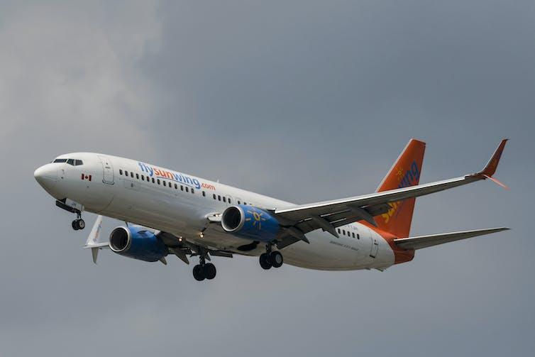 A Sunwing passenger plane prepares to land.