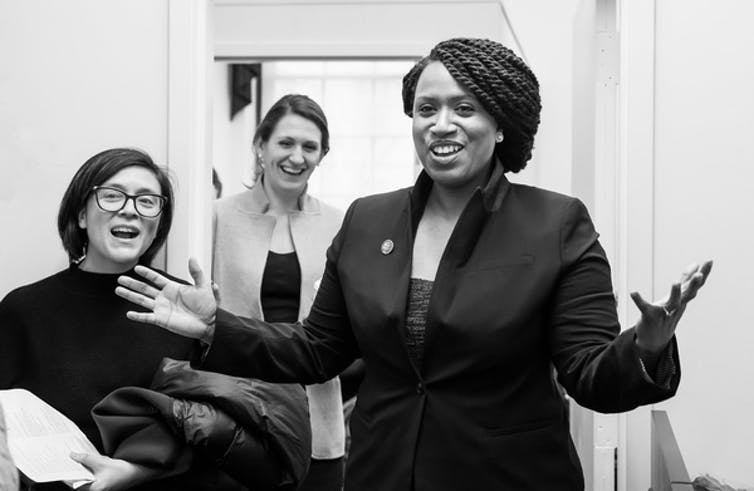 Ayanna Pressley greets visitors to her office at the U.S. Capitol.