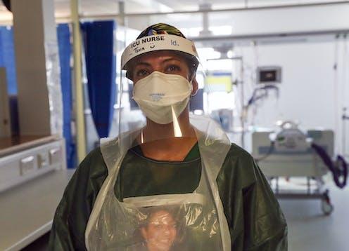 A nurse wears PPE at a hospital