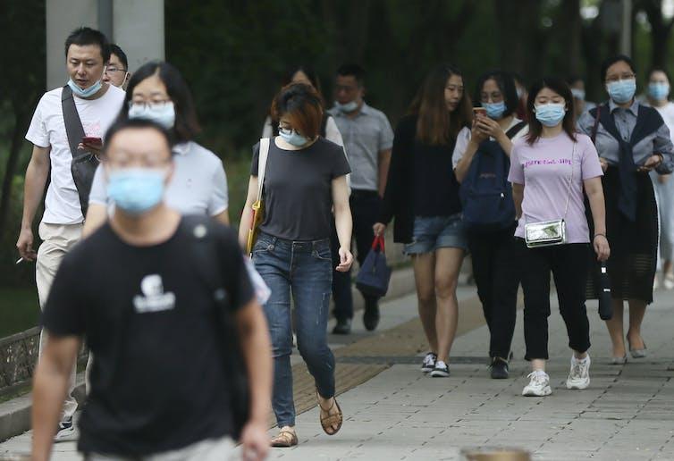 People in South Korea walk wearing face masks