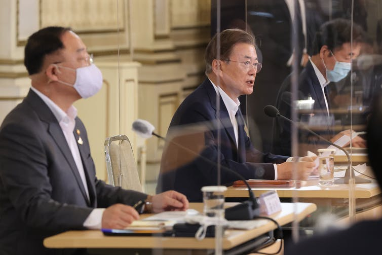 South Korean President Moon Jae-in, centre, discussing the K-New Deal