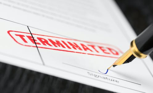 Terminated stamp on a contract being signed
