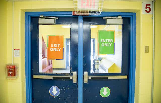 Signs on doors say 'exit only,' and 'enter only.'
