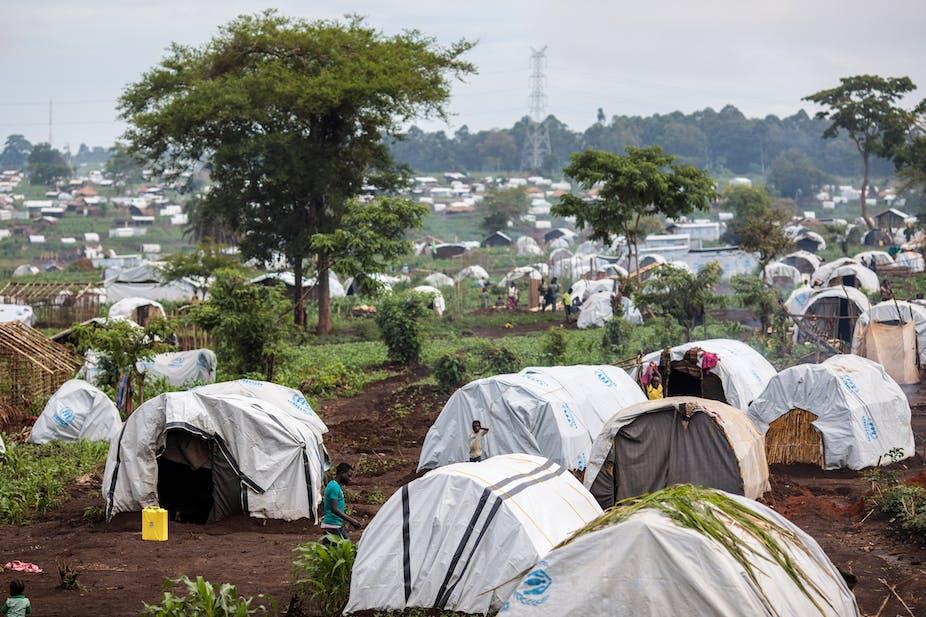 Landscape full of white tents