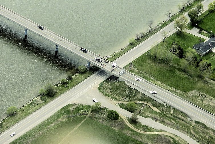 An areal view of a highway blockade over Grand River.