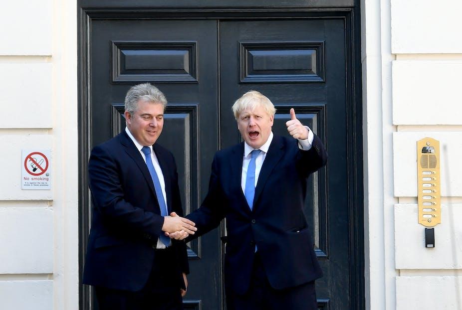 Brandon Lewis and Boris Johnson shaking hands.