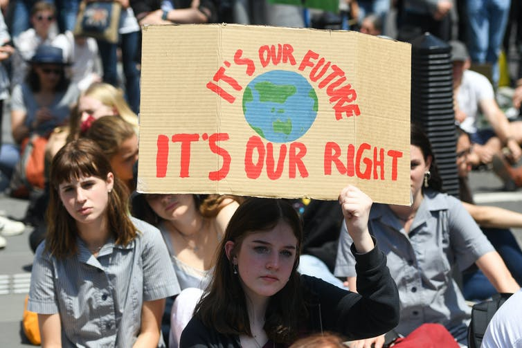 A climate protest, with a sign that says 'it's out future, it's our right'.