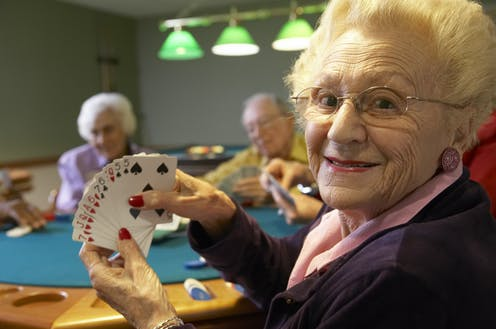 Group of older people playing bridge