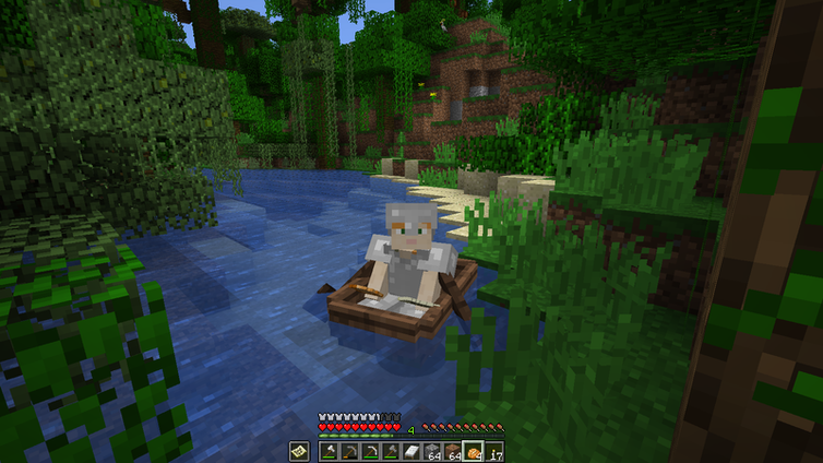 A minecraft character on a screen rowing a boat, surrounded by greenery