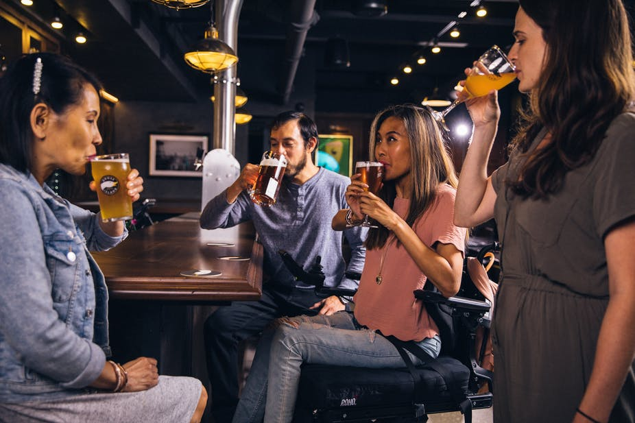 A group of four people drinking beer.