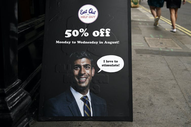 Billboard advertising Eat Out to Help Out with picture of Chancellor Rishi Sunak