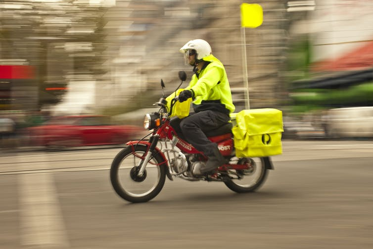 Postie on a motorbike