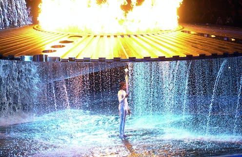 Cathy Freeman under the Sydney Olympic cauldron