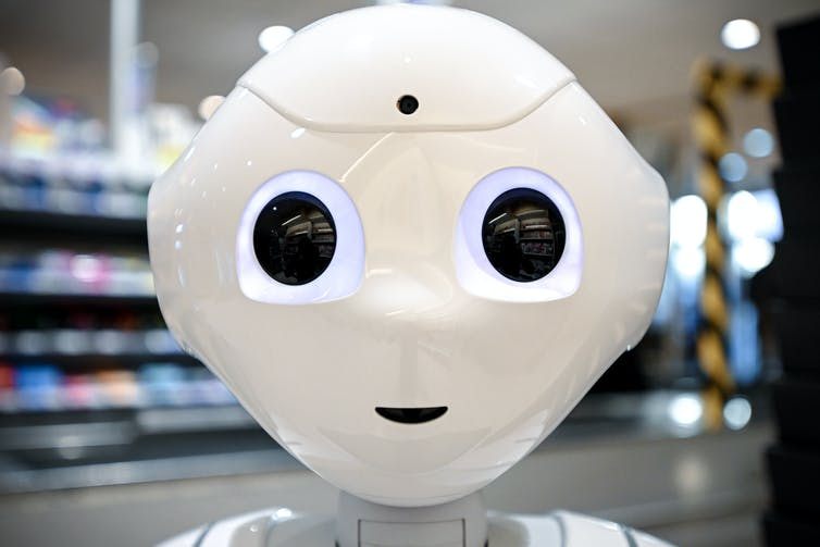 Close-up of a white robot face.