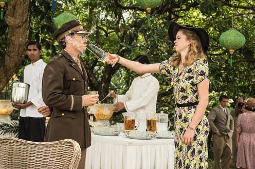 A woman throws a drink in an army officer's face at a garden party.