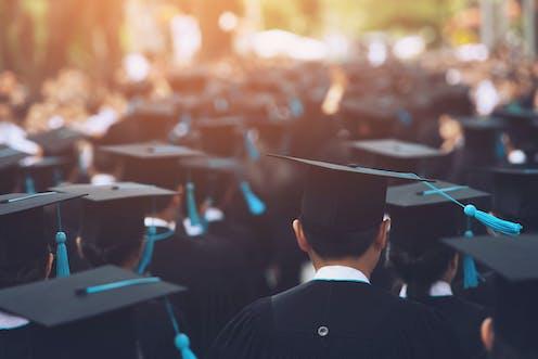 University graduates in their academic gear on graduation day.