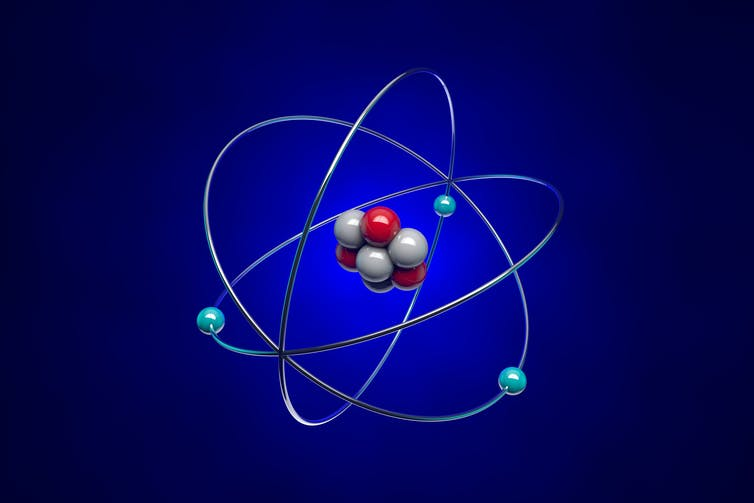 A simplified illustration of an atom showing protons, nucleons and electrons