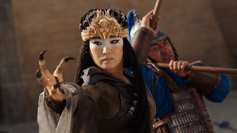 Xianniang reaches towards the camera with an eagle's claw for a hand.