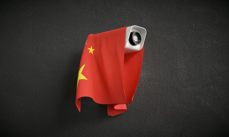 Illustration of surveillance camera with Chinese flag draped over.