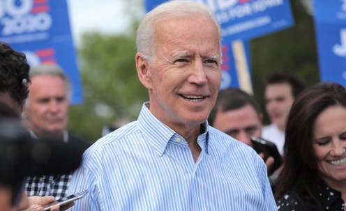 Democratic presidential nominee Joe Biden with a group of people outdoors