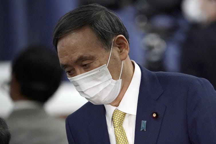 Yoshihide Suga wearing a face mask.