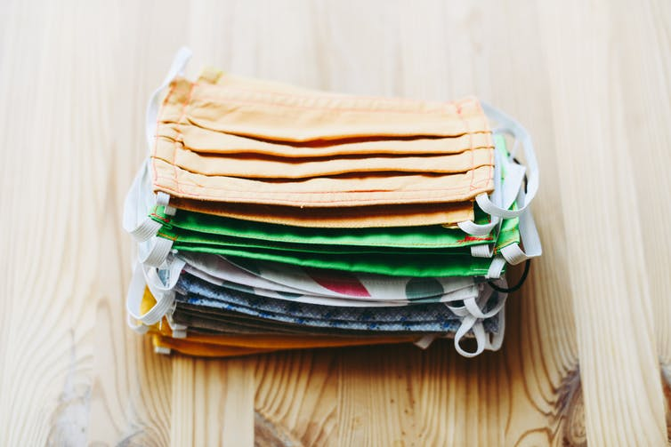 A stack of colourful cloth masks