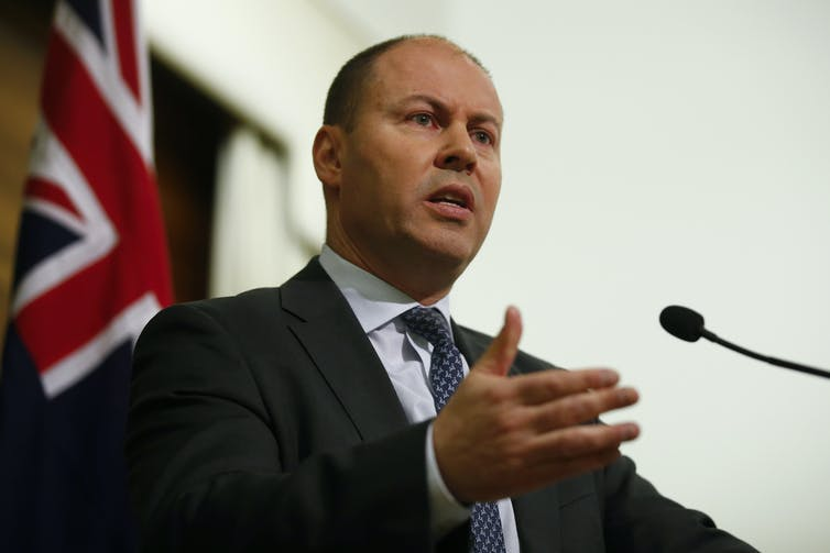 Treasurer Josh Frydenberg speaking at a press conference.