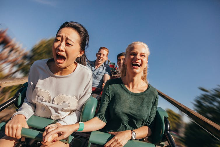 Girls screaming on rollercoaster