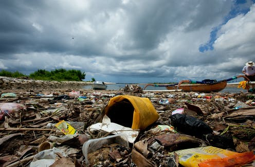 Plastic containers, wrappers and bags washed up on a beach