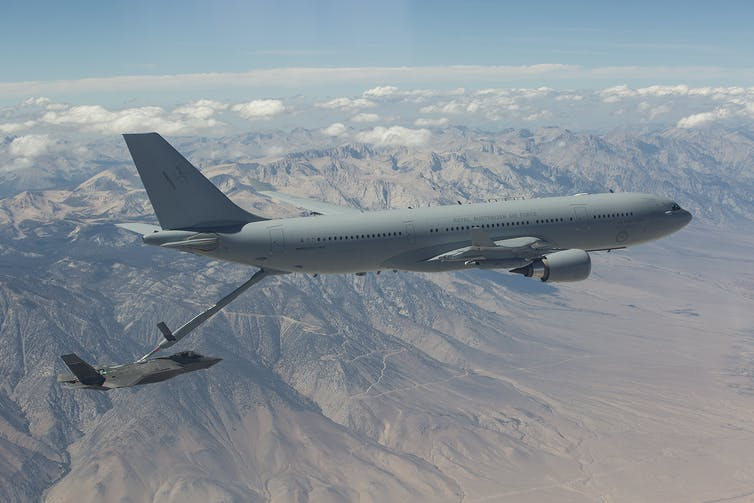 KC-30 Tanker flying over a mountain range.