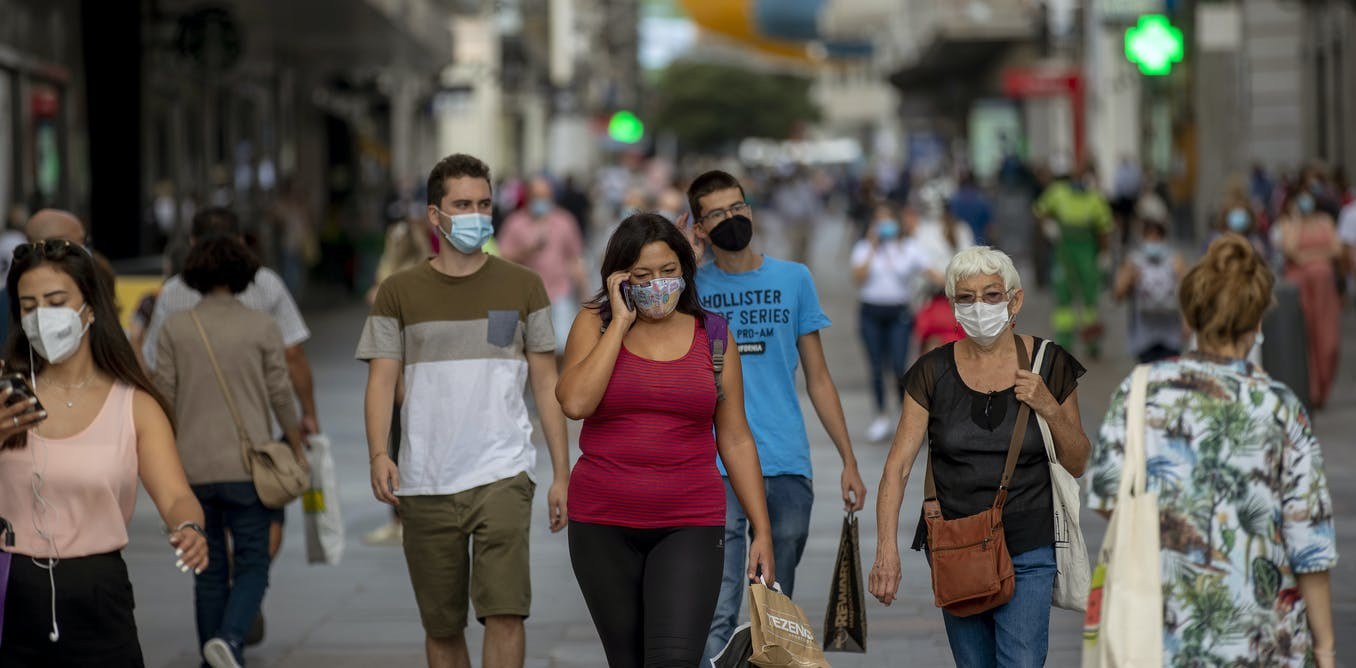 How could wearing a mask help build immunity to COVID-19? It's all about the viral dose