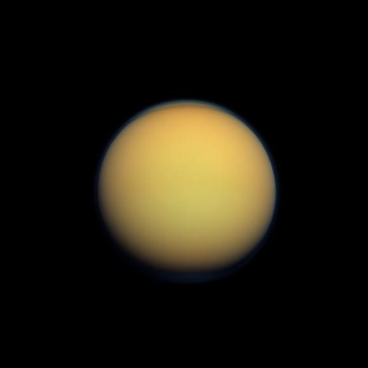 Yellow/orange moon Titan in space