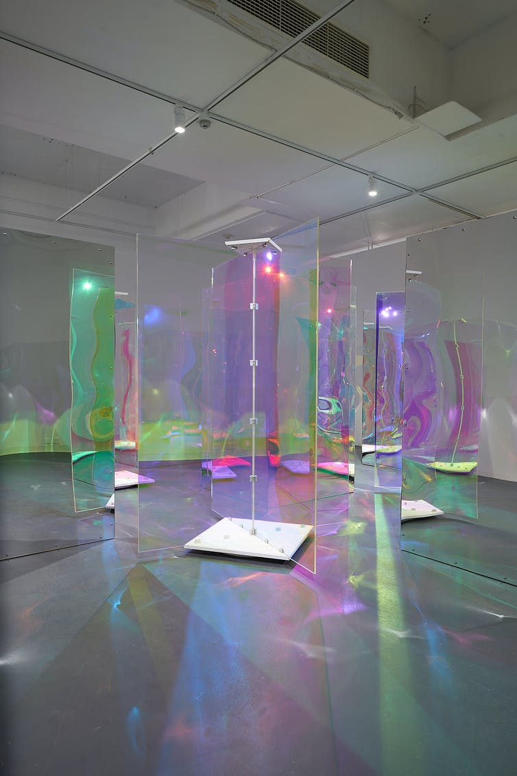 A room filled with glowing perspex doors