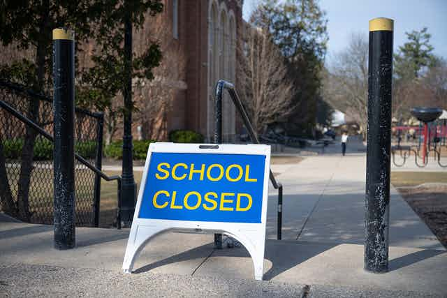 A closed sign outside a school.