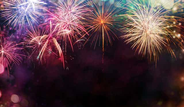 Multicoloured fireworks exploding in sky