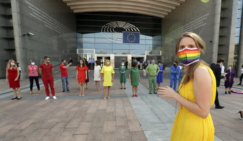 Members of the European Parliament dress in rainbow colours outside their building