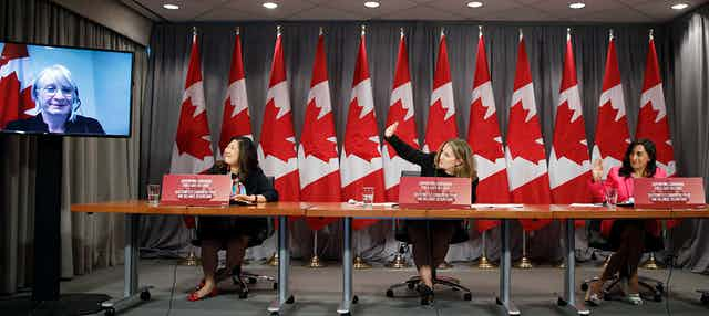 Chrystia Freeland is seen with three other women cabinet ministers at a news conference.
