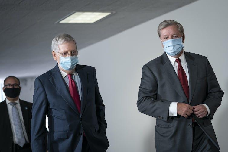 Senate Majority Leader Mitch McConnell and Sen. Lindsey Graham walking together