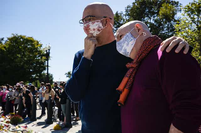 Michael Widomski (L) and David Hagedorn (R) at the makeshift memorial for Justice Ginsburg in front of the US Supreme Court.